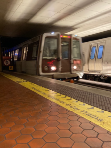 Red Line train taking off at the Gallery Place Metro stop in Washington, DC on January 28, 2021. (Photo elements: Medium-shot, motion, shadow)
